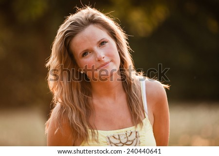 Beautiful Blonde Young Woman in sunset meadow summer day closer
