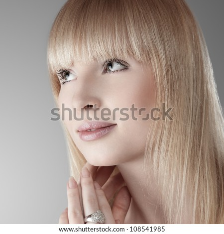 Beautiful blonde young woman studio portrait - stock photo