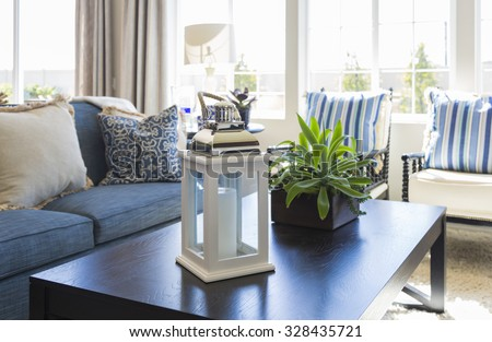 Beautiful Blue Accented Living Area with Coffee Table, Couch and Chairs of Home. - stock photo