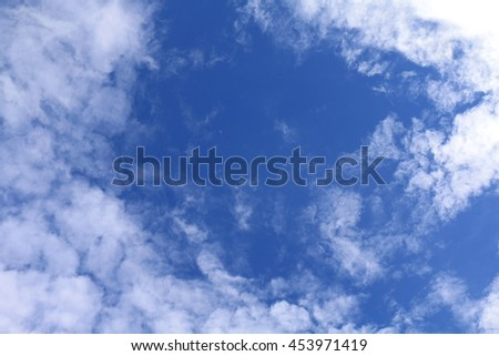 Beautiful blue and small moon on sky with clouds for background and bright lighting clear on Summer - stock photo