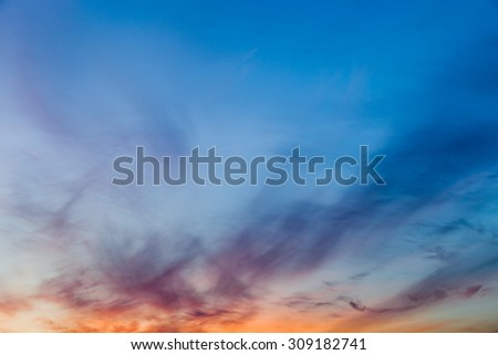 Beautiful blue and yellow sky with sunset. - stock photo