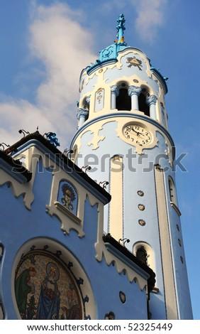 beautiful blue art nouveau style church tower - stock photo