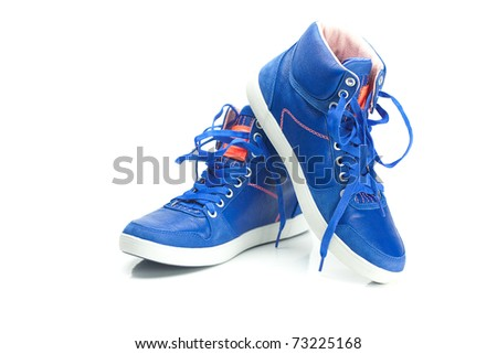 beautiful blue athletic shoes isolated on white - stock photo