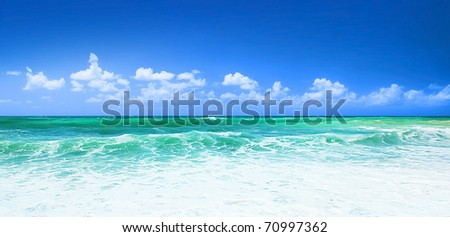 Beautiful blue beach panoramic sea view, with clean water & blue sky - stock photo
