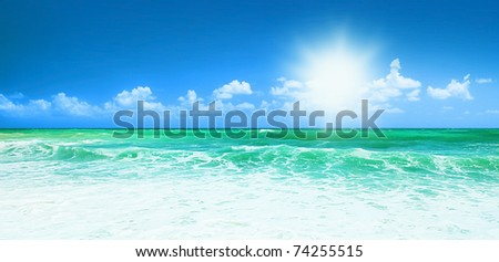 Beautiful blue beach panoramic sea view, with clean water & blue sky, concept of vacation & peace - stock photo