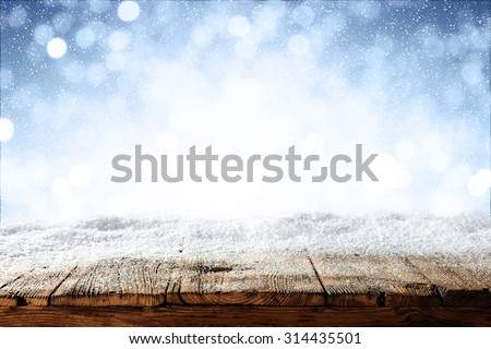 beautiful blue blurred background of winter and shabby table  - stock photo