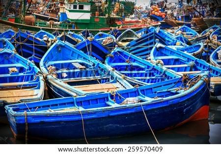 Beautiful blue boats in old Essaouira harbor, Morocco - stock photo