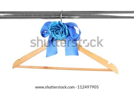 Beautiful blue bow hanging on wooden hanger isolated on white - stock photo