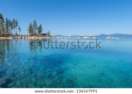 Beautiful blue clear water on the shore of the lake Tahoe - stock photo