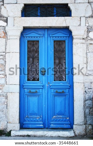 Beautiful blue door in Mediterranean style. - stock photo