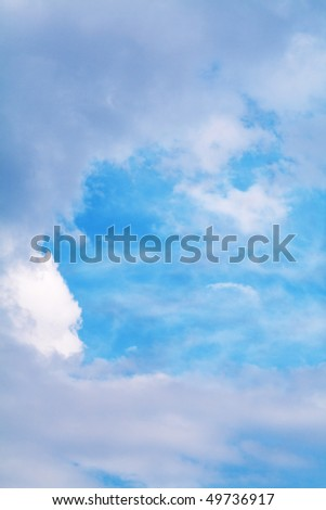 Beautiful blue dreamy sky framed with clouds - stock photo