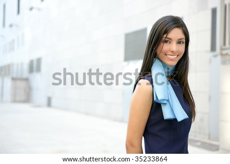 Beautiful blue dress stewardess walking to convention center - stock photo