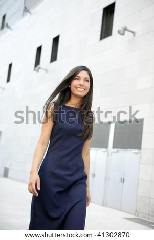 Beautiful blue dress stewardess walking to in the city - stock photo