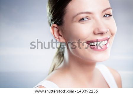 Beautiful blue-eyed Caucasian woman smiling. - stock photo