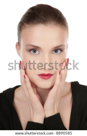 Beautiful blue-eyed glamorous girl with professional makeup touching her face - stock photo