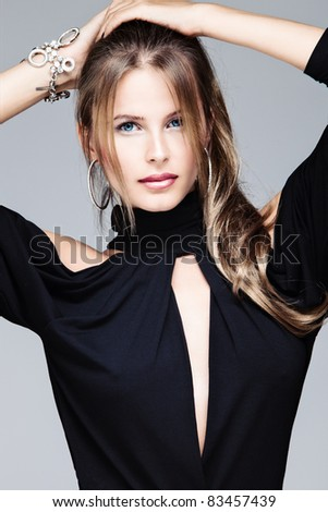 beautiful blue eyes woman in black dress, studio portrait