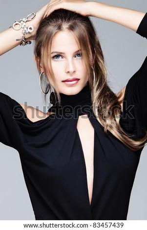 beautiful blue eyes woman in black dress, studio portrait - stock photo