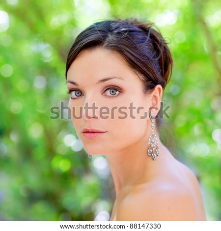 beautiful blue eyes woman outdoor green park portrait - stock photo