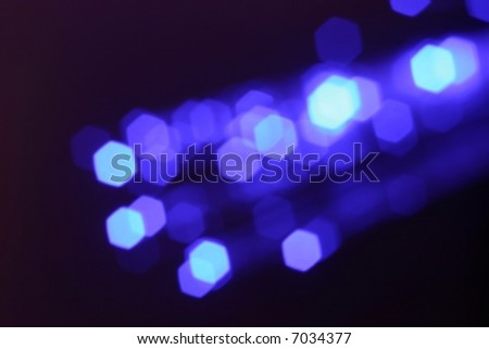 Beautiful blue fiber optics abstract background - stock photo