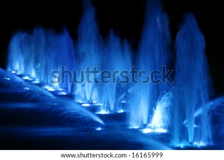 Beautiful blue fountains at night - stock photo