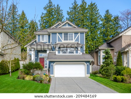 Beautiful blue house on a sunny day in Vancouver, Canada. - stock photo