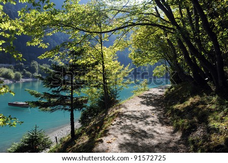 Beautiful blue lake in Italy - stock photo