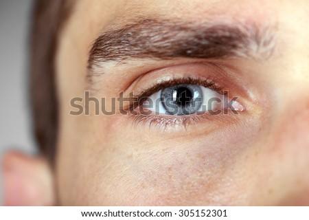 Beautiful blue man eye close up - stock photo