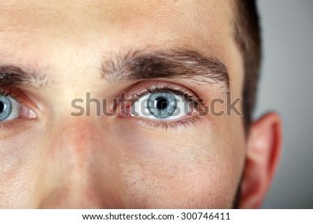 Beautiful blue man eyes close up - stock photo