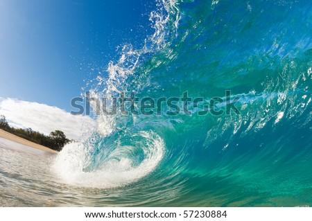 Beautiful Blue Ocean Wave breaking on Sunny Beach - stock photo