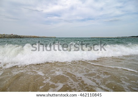 Beautiful blue ocean waves in Terengganu, Malaysia with cloudy sky background at sunny day