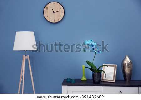 Beautiful blue orchid flower on the table in modern room - stock photo