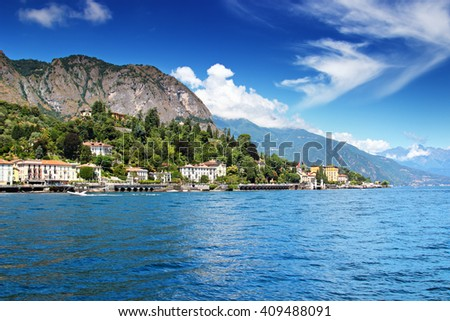 Beautiful blue peaceful Como lake in sunny day, Cadenabbia, Italy. - stock photo
