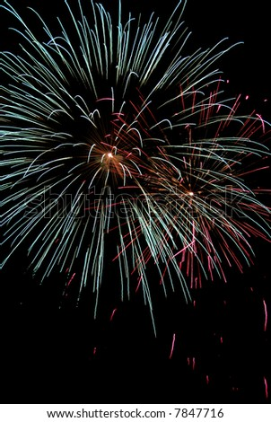 beautiful blue, red and yellow fireworks on black background
