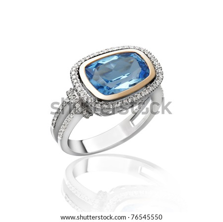 Beautiful blue sapphire ring decorates with diamonds an image isolated on white - stock photo