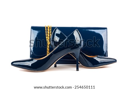 Beautiful blue shoes with clutches on white isolated background - stock photo