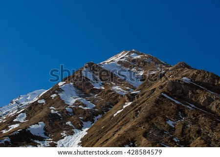 Beautiful blue skies with clouds over the mountains in the snow. Winter landscape - stock photo