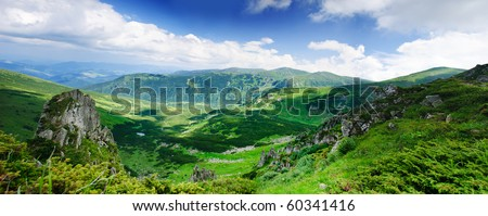 Beautiful blue sky and rock high up in Carpathian mountains - stock photo