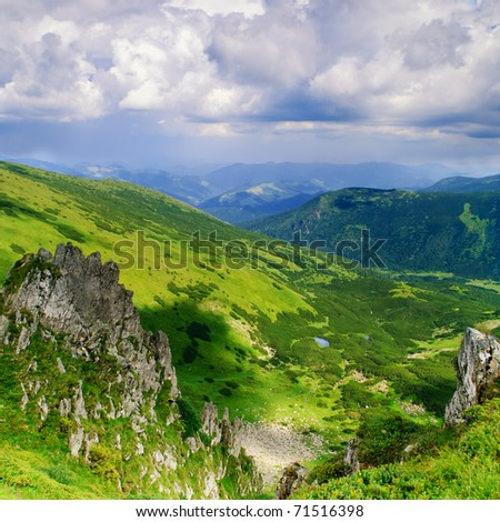 Beautiful blue sky and rock high up in Carpathian mountains, Czarnohora ridge - stock photo