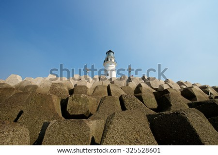 Beautiful blue sky at harbor lighthouse in Qingdao - stock photo