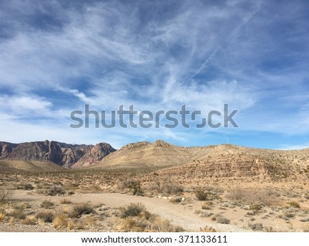 Beautiful blue sky over a dry desert dirt road  in Death Valley California  - stock photo