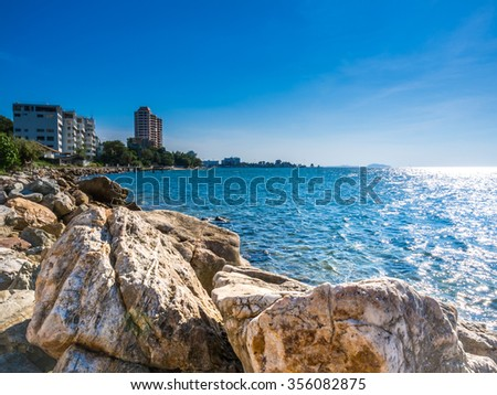 Beautiful blue sky, sea and rocks at Bang Saen Thailand.