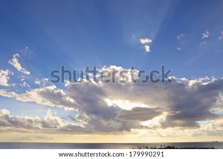 beautiful blue sky with clouds and sun ray. - stock photo