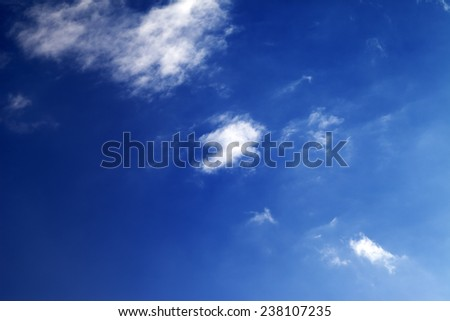 Beautiful blue sky with clouds at nice winter windy day - stock photo