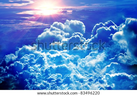 Beautiful blue sky with sunbeams and clouds - stock photo