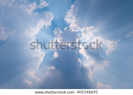 Beautiful blue sky with sunbeams and clouds. Sun rays - stock photo