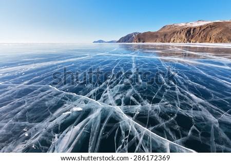 Beautiful blue smooth ice on Baikal Lake in February - stock photo