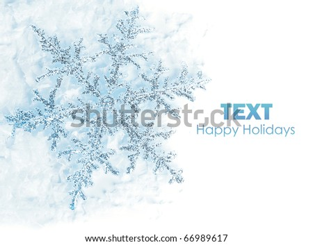 Beautiful blue snowflake isolated, winter holiday background with copy space - stock photo