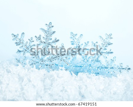 Beautiful blue snowflake winter holiday background - stock photo