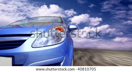 Beautiful blue sport car on road - stock photo