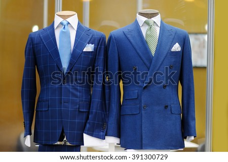 Beautiful blue suits with tie, tie clip and handkerchief on a mannequin  - stock photo